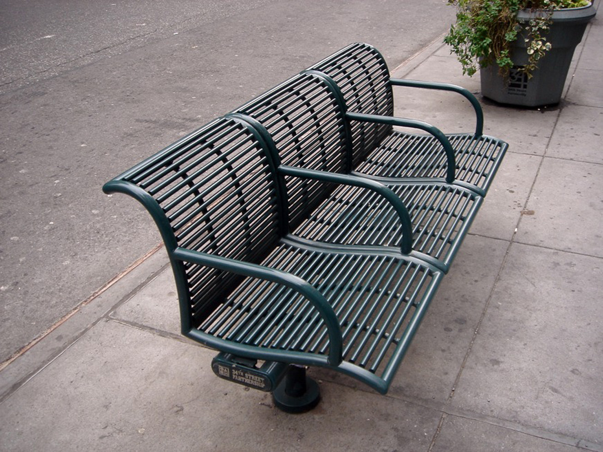 Bench designed to keep homeless people off of it