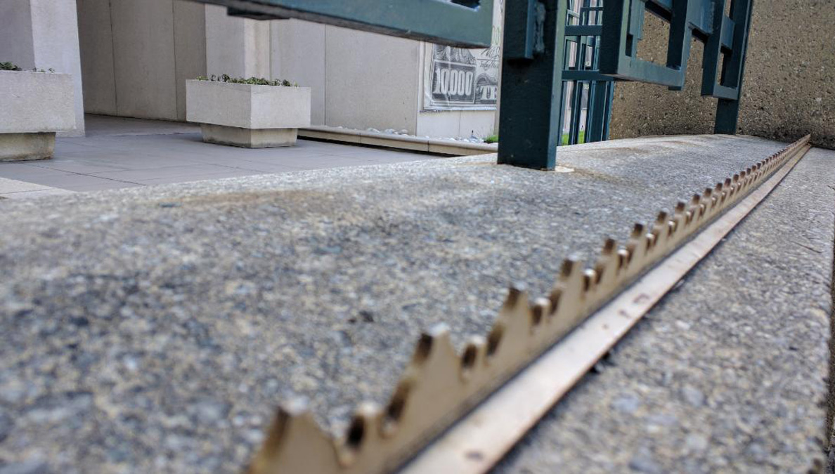 Ledge with spikes to discourage skate boarding and sitting